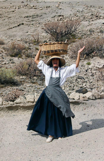 A woman in traditional clothes carrying a basket on her head selling fruit Basket Basket On The Head Casual Clothing Hawker Lifestyles Nature Occupation Outdoors Spain♥ Tenerife Traditional Clothing Traditional Culture