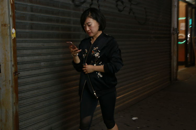 Adult Angle Asian  Building Exterior Canon 70d City Flash Photography Girl Holding IPhone Night Night Photography One Person Outdoors People Real People Rose Gold Sigma 30mm/1.4 Standing Streetphotography Technology Wireless Technology Young Adult Young Women