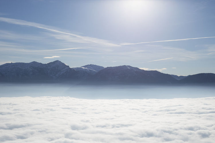 Scenic View Of Cloudscape And Mountains Against Sky