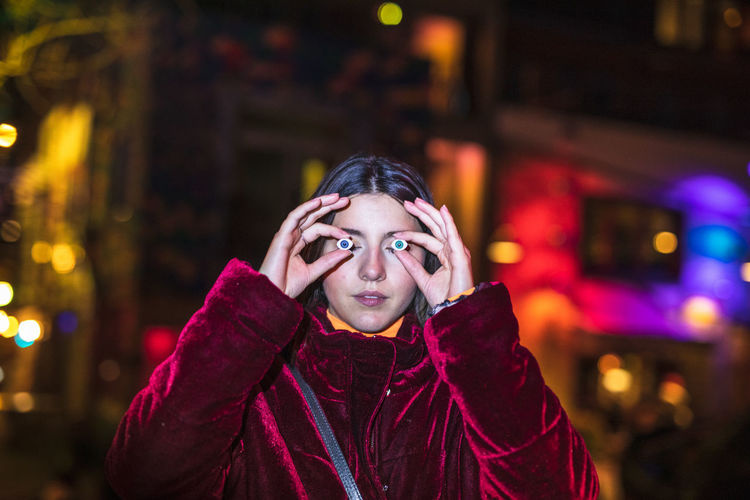 Portrait Headshot One Person Front View Night Clothing Looking At Camera Young Adult Winter Illuminated Warm Clothing Focus On Foreground Standing Emotion Young Women Lifestyles City Scarf Teenager Hood - Clothing Adolescence