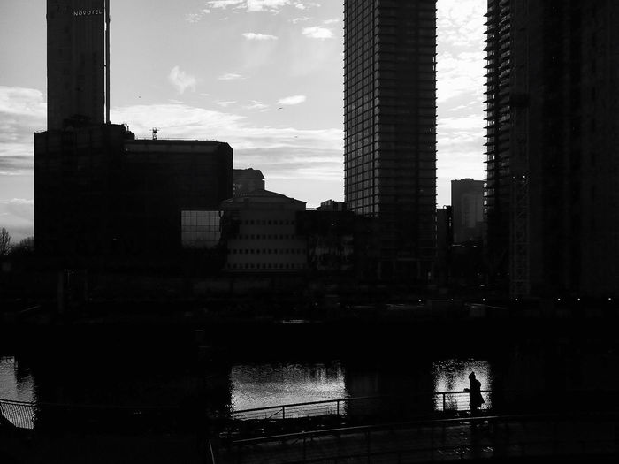 Reflection of silhouette buildings in city