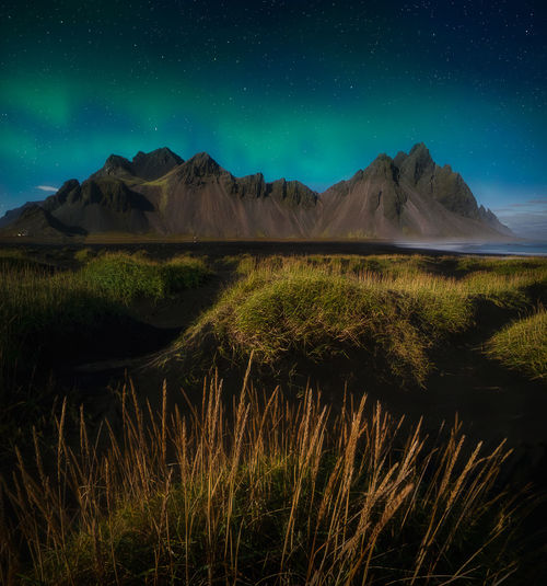 Mountain Sky Scenics - Nature Beauty In Nature Mountain Range Nature Grass Non-urban Scene Tranquility Green Color Plant Night Outdoors Mountain Peak Landscape Landscape_photography Iceland Aurora Borealis Northern Lights Vestrahorn Stokksnes Night Photography No People EyeEm Best Shots Long Exposure