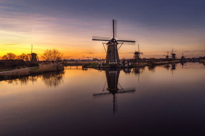 Colors EyeEm Best Shots EyeEm Nature Lover Reflection Sky And Clouds Sunset Silhouettes Windmills Dutch Holland Kinderdijk Reflections In The Water Remo SCarfo Sunset Sunset #sun #clouds #skylovers #sky #nature #beautifulinnature #naturalbeauty #photography #landscape