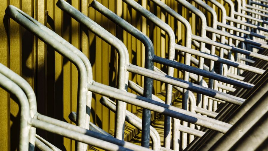 Park your bike! Pattern No People Textured  Close-up Indoors  Day Bikes Bike Parking Area Rack Yellow Metal Bicycle Bicycle Parking Bicycle Rack Bicyclelife Abstract Abstract Photography Patterns & Textures Pattern, Texture, Shape And Form Conceptual Copy Space Iron - Metal Transport