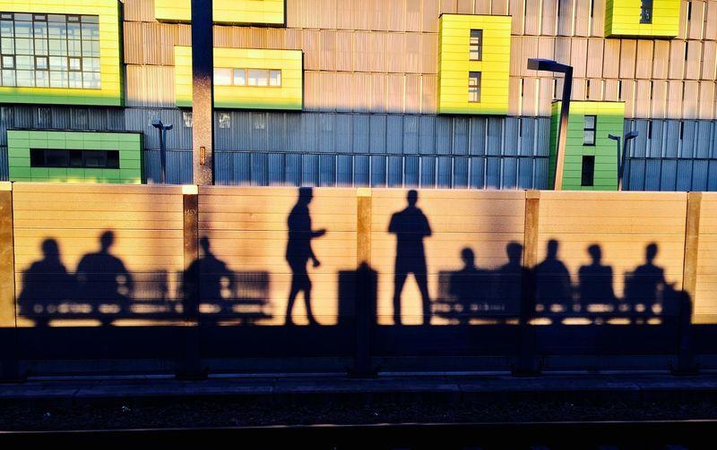 Shadow Of People At Railroad Station Platform