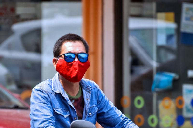 Man wearing mask and sunglasses