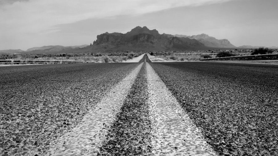 Brown Road to Superstition Mountain on a Dusty day Apache Junction Arizona EyeEm Best Shots Mountain Rural Scene Road Agriculture Sky Landscape