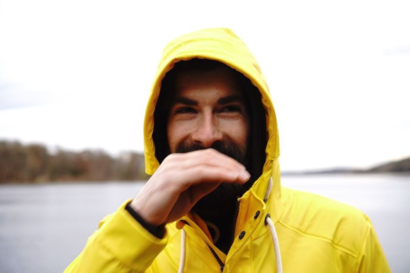 Enjoy The New Normal Portrait Real People Headshot Yellow Portrait Photography Portrait Of A Man  Faces Of EyeEm Face Laugh Close-up Outdoors Lifestyles Bokeh Men Real Photography Young Adult Only Men Focus On Foreground Headwear One Person One Man Only The Portraitist - 2017 EyeEm Awards