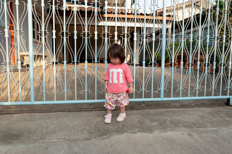 Childhood Child One Person Full Length Girls Innocence Females Casual Clothing Standing Architecture Front View Day Offspring Women Portrait Number Outdoors Hairstyle Shorts Bangs