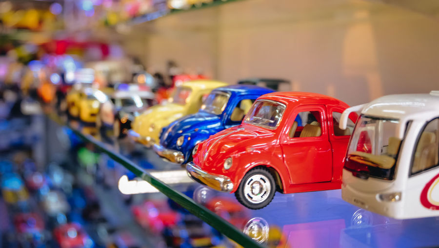 Car Close-up Focus On Foreground Indoors  Multi Colored Selective Focus Toy Toy Car Transportation