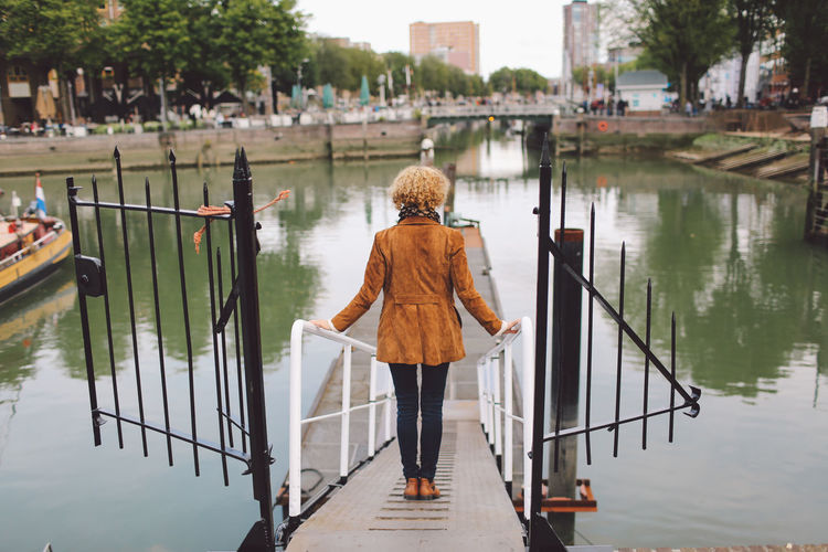 Adult Adults Only Blond Hair Bridge - Man Made Structure Day Full Length Nature One Person One Woman Only Only Women Outdoors People Rear View River Water