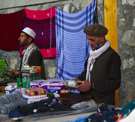 People standing at market stall