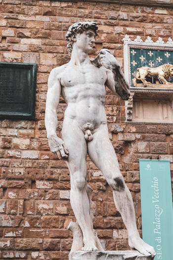 michelangelo Florence Italy Florence Italy Canonphotography Canonm100 EyeEm Selects Statue Sculpture Human Representation Male Likeness Architecture Building Exterior Built Structure Historic Art Art And Craft Craft ArtWork Craft Product Brick Wall Street Art Carving - Craft Product