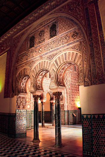 Architecture Check This Out EyeEm Gallery Reales Alcazares De Sevilla Sevilla Travel Arabic Style Arch Architectural Column Architecture Built Structure Day Eye4photography  Illuminated Indoors  Luxury No People Ornate Realesalcazares Travel Destinations