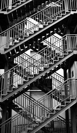 The Street Photographer - 2017 EyeEm Awards Architecture Railing Metal Steps And Staircases Built Structure Staircase Fire Escape Low Angle View Building Exterior Outdoors City