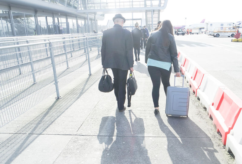 Couple Travel Traveling Adventure Airport Day Flying Fresh Start Full Length International Airport Luggage Luggage Trolleys Luggage, Travel  Men New Beginning Outdoors Passengers Shadow Starting Over Suitcase Sunlight Togetherness Transportation Vacation Walking Colour Your Horizn