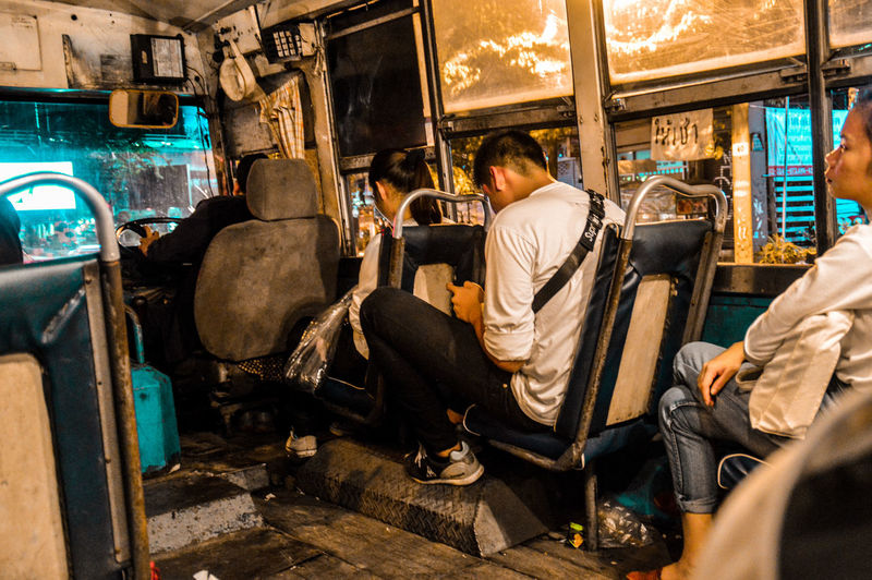 The long bus ride home after an even longer day of work. This is what a working class hero's life looks like Bus Ride Home Sitting Real People Lifestyles Adult People Bangkok City City Life Working Class Heros
