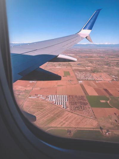 Travelling Manwork Plane Airplane Air Vehicle Mode Of Transportation Transportation Aircraft Wing Window Flying Nature Travel Sky No People Transparent Glass - Material Vehicle Interior Day Landscape Sunlight Environment Journey Outdoors