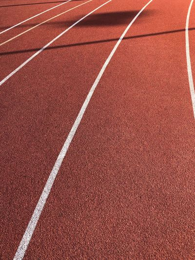 Running road EyeEm Selects EyeEmNewHere Sport Track And Field Running Track Competition Competitive Sport No People Sports Track Red Day Backgrounds Tennis Pattern Full Frame Textured  Outdoors Court High Angle View Dividing Line Close-up White Color