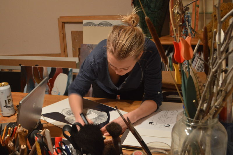 High angle view of woman painting on table