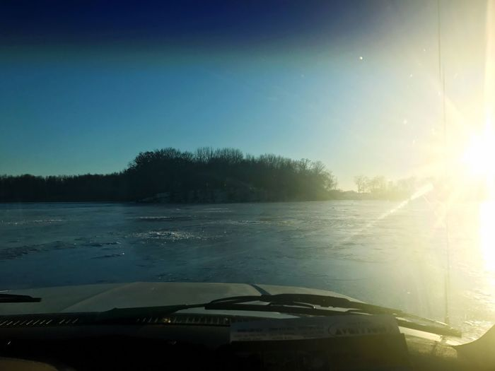 Being out on the iced over lake is where my heart belongs. ☺️ Scenics Fishing Transportation Car Tree Sky Nature Mode Of Transport Clear Sky Land Vehicle Sunlight Windshield No People Beauty In Nature Vehicle Interior Car Interior Car Roof Water Day Outdoors Sunset