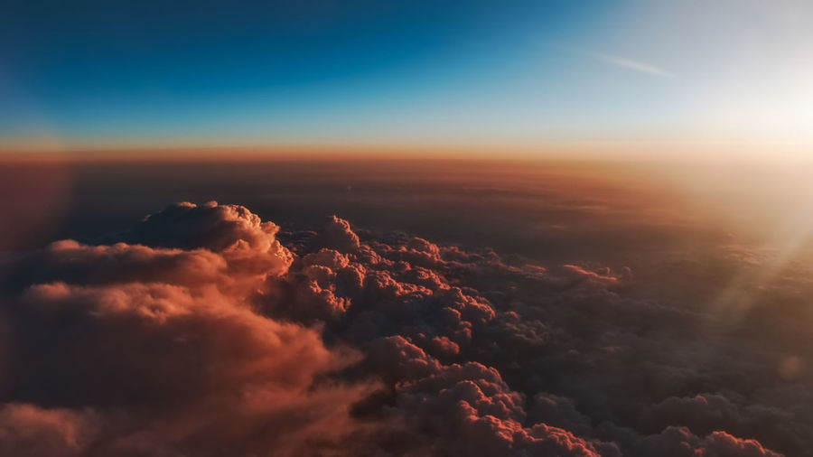 Aerial view of clouds in sky during sunset