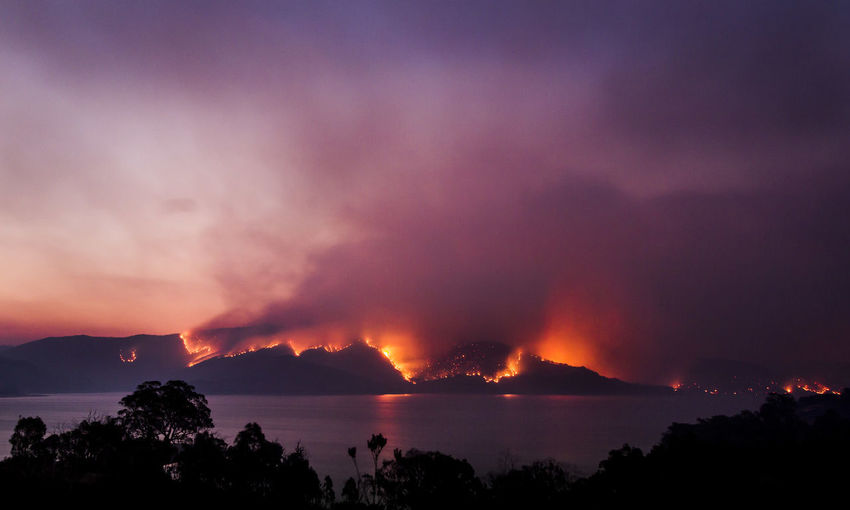 Bushfires on the lakeshore, Blowering NSW Australia Australian Landscape Beauty In Nature Darkness And Light Fire First Eyeem Photo Horizontal Lake Lakeshore Lightning Nature Night No People Outdoors Power In Nature Scenics Sea Silhouette Storm Cloud Sunset Thunderstorm Wildfire