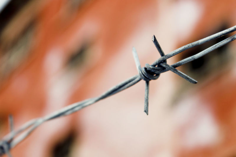 Low angle view of barbed wire