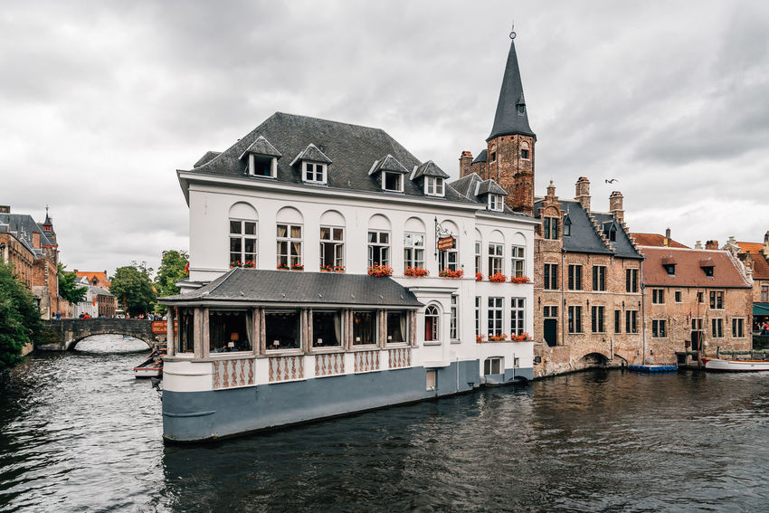 Cityscape of the medieval city of Bruges Architecture Building Exterior Built Structure Canal Canals Canals And Waterways City Cloud - Sky Day History Mode Of Transport Nature Nautical Vessel No People Outdoors Sky Transportation Travel Destinations Water Waterfront