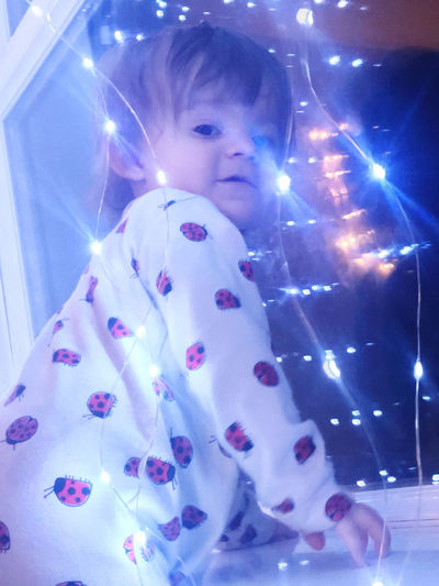 Portrait of cute girl with illuminated lights