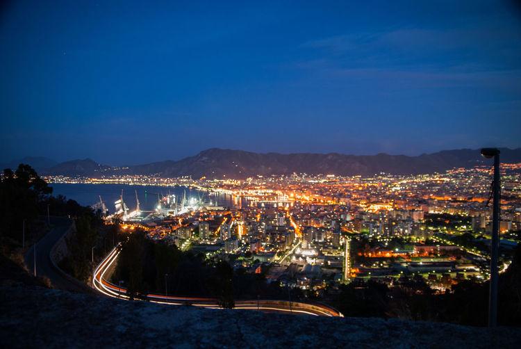 Palermo EyeEm Selects City Car Night City Cityscape Illuminated Mountain Light Trail Sky Architecture Landscape Calm Vehicle Light Mountain Range Tail Light Headlight