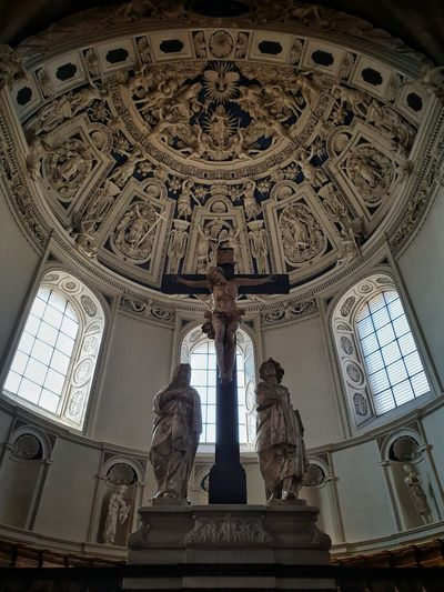 Low angle view of statue against ceiling