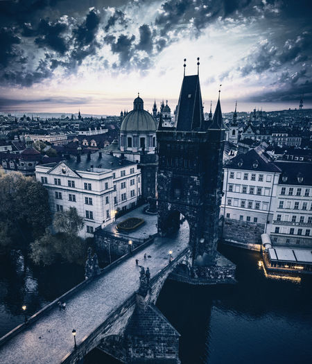 High angle aerial view of charles bridge in prague against cloudy sky at the sunrise
