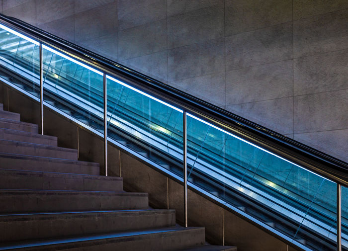 Best Of Stairways Futuristic Absence Architecture Building Built Structure Day Diagonal Lines Escalator Glass - Material Indoors  Low Angle View Modern Neon Lights No People Railing Reflection Staircase Steps And Staircases Technology Transparent Wall - Building Feature Window