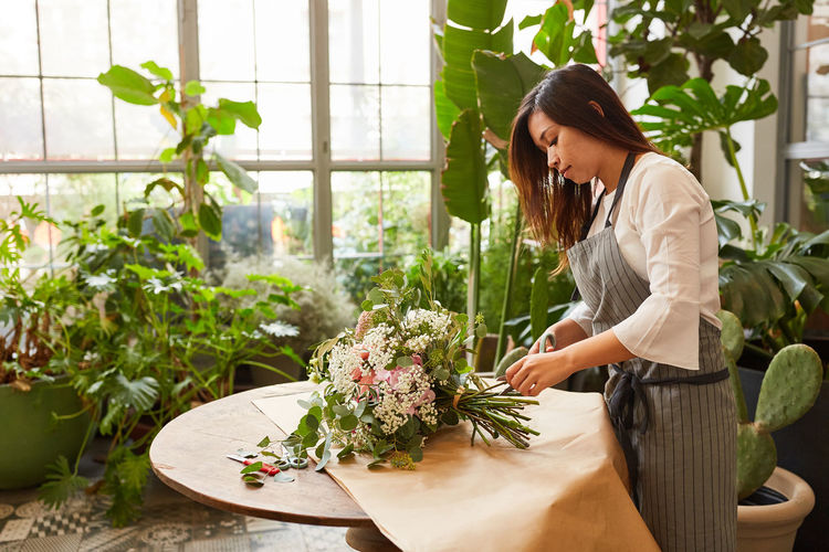 Woman looking at potted plants