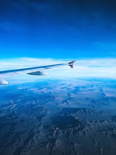Flying over alien lands. Far West Sky Blue Flying Air Vehicle Airplane Mid-air Nature Mode Of Transportation Beauty In Nature Scenics - Nature Water Cloud - Sky Tranquil Scene Travel No People Outdoors Transportation Motion Sea Day