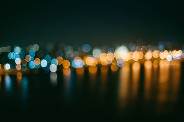 Abstract Bokeh Circle City Dark Defocused Geometric Shape Glowing Illuminated Lens Flare Light Light - Natural Phenomenon Lighting Equipment Multi Colored Night Nightlife No People Outdoors Pattern Rain Reflection Shape Spotted Street Water
