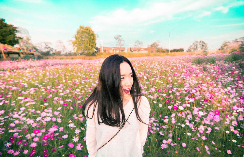 Young Woman Against Flowering Field