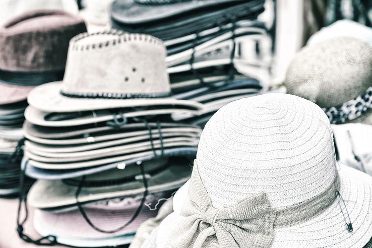 Close-up of stacked hats at market
