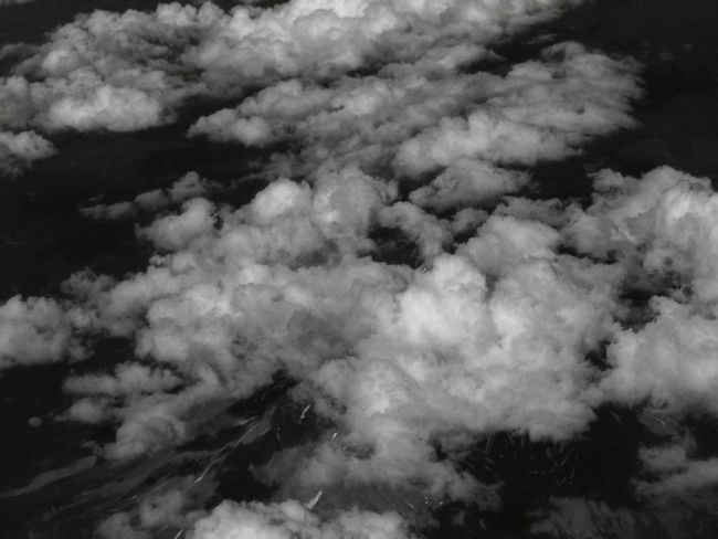 Mount Shasta surrounded in clouds from high up in an airplane. Aerial View Backgrounds Beauty In Nature Cloud Cloud - Sky Cloudscape Cumulus Cloud Day Dreamlike Environment Ethereal Fluffy Full Frame Heaven Idyllic Majestic Meteorology Mountain Nature Non-urban Scene Scenics Sky Softness Tranquil Scene Tranquility