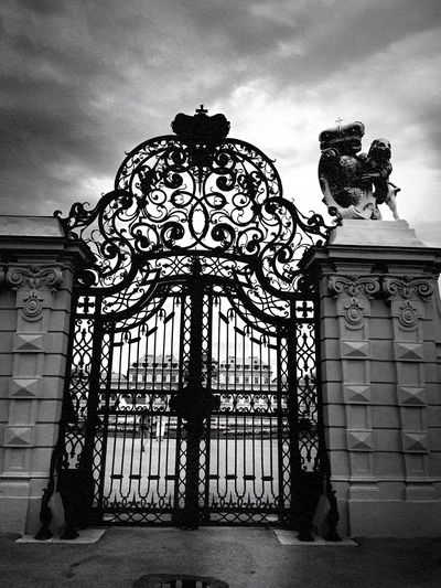 The door Bnw_captures Bnw_collection EyeEm Selects Bnw_gateway2018 Bnw_friday_eyeemchallenge Cloud - Sky Architecture Low Angle View Sky Day Built Structure No People Outdoors Building Exterior Sculpture Statue