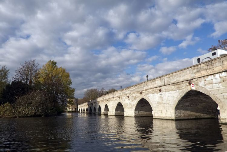 Clopton Bridge. Bridge Built Structure Water Connection Architecture Bridge - Man Made Structure Arch Cloud - Sky Sky Tree Nature Arch Bridge River Waterfront Transportation Plant Day No People Building Exterior Outdoors Arched EyeEmNewHere
