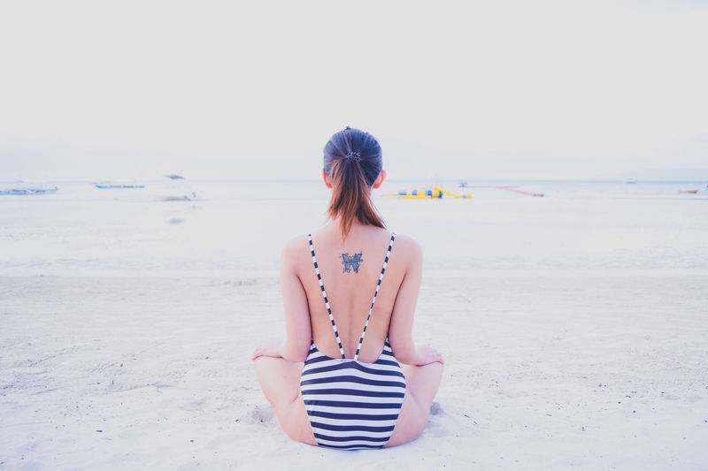 Rear View Sea Clear Sky Relaxation Water Vacations Beach Scenics Casual Clothing Copy Space Tranquil Scene Escapism Tranquility Long Hair Solitude Beauty In Nature Idyllic Eyeem Philippines Bohol Philippines Bellevue Kev&jen Nature Vacations