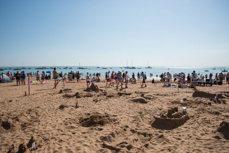 Darwin, Northern Territory, Australia-July 22,2018: Crowds on the Timor Sea coast with nautical vessels during the Beer Can Regatta at Mindil Beach in the NT of Australia Darwin Nautical Vessel Beer Can Regatta Event Festival Annual Event People Tourist Tourism Travel Travel Destinations Timor Sea Sea Ocean Shore Coast Shoreline Coastline Seascape Horizon Over Water Northern Territory Australia Leisure Activity Recreational Pursuit Fun Lifestyles Party Gathering Socializing Party - Social Event Beach Mindil Beach Large Group Of People Friends Vacations Transportation Tropical Dusk Twilight Sunset Sky Crowd Sand Holiday Trip Copy Space Nature Water Group Of People Sandcastle