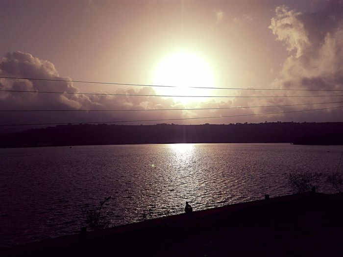 Bhandardara. Sunset Skylover Blazinghotsun Perfect Click BirdNaturelover Reflection Beauty In Nature Sunbeam Scenics Water Nature Sunlight Flying Animal Themes Sun Sunlight Animals In The Wild Horizon Over Water Flock Of Birds Tranquil Scene Scenics Tranquility Sunset First Eyeem Photo