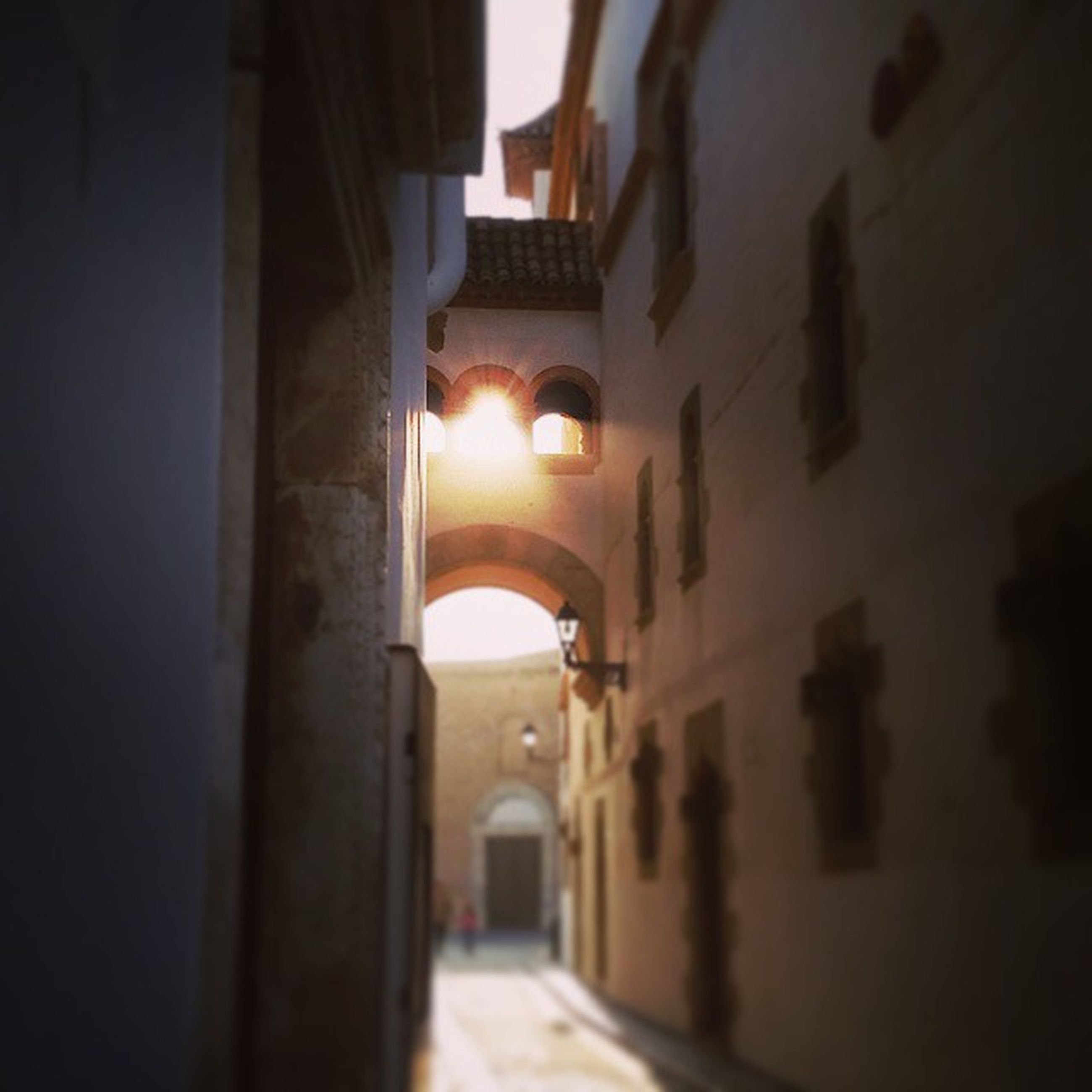 architecture, built structure, building exterior, illuminated, the way forward, night, indoors, building, lighting equipment, narrow, arch, residential building, corridor, diminishing perspective, alley, residential structure, empty, house, no people, dark