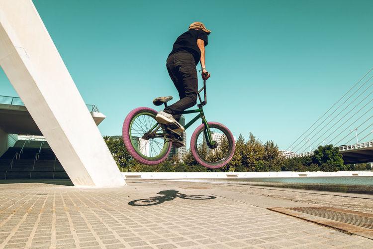 Young man doing street tricks with a bmx Street Fun Urban Flying Sports Bike Riding Bicycle Sport Jump Cyclist Park Biker Bmx  Cycle Tricks Trick  Ramp Bmxlife Young Adult Extreme Sports Bmxbike Ridingbmx Bmx Cycling Bmxbikes