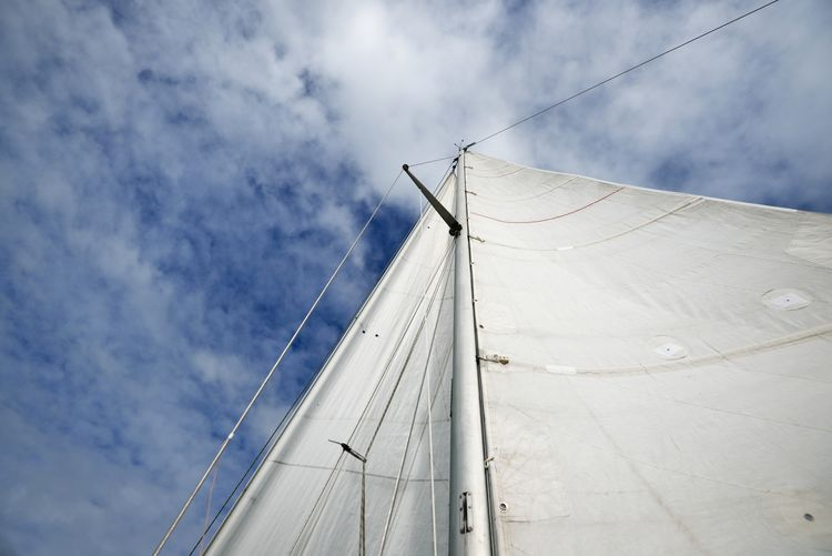 Low angle view of sailboat on sea against sky
