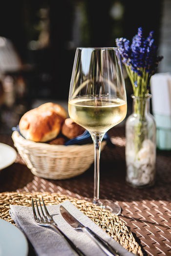 Glass of cold white wine and fresh pastries