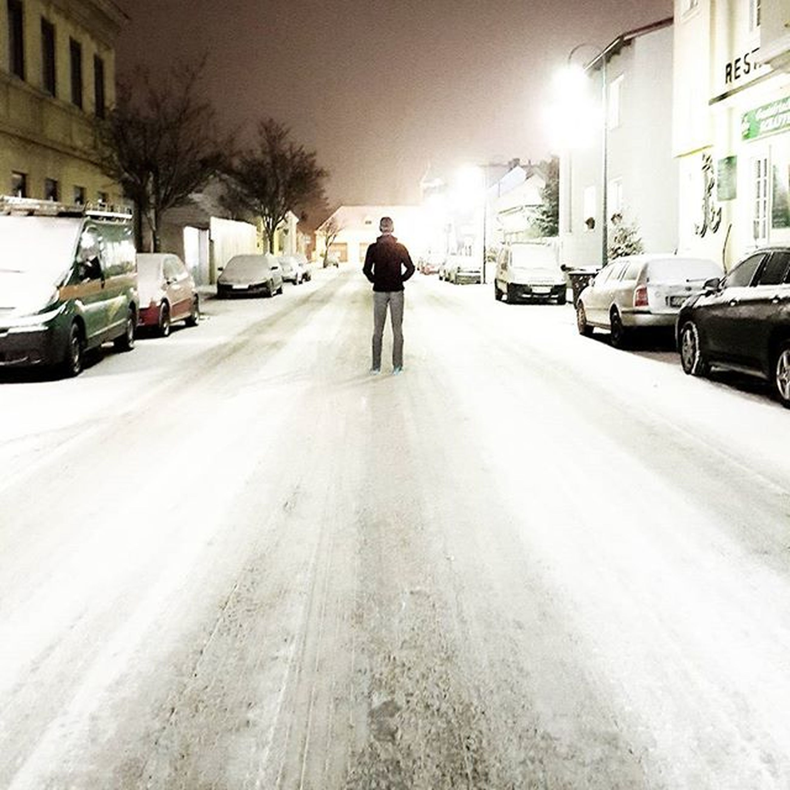 building exterior, snow, winter, street, transportation, the way forward, architecture, cold temperature, walking, full length, built structure, rear view, car, season, city, weather, road, land vehicle